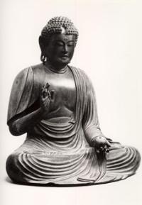 El Buda de madera de Sanar la imagen sedentaria