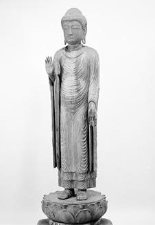 Buda de madera la estatua