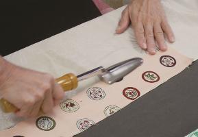Kimono dressmaking person is state using iron of iron