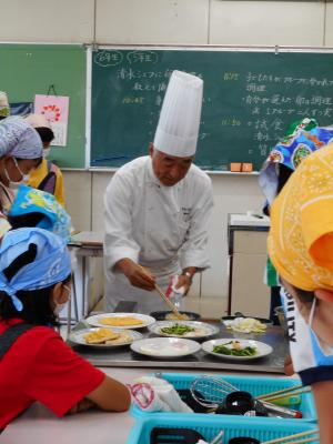 It looks like Ikuo Shimizu Meister performs lecture of food education