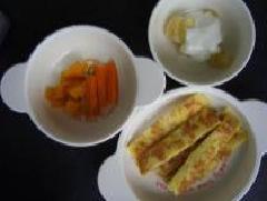 French toast, carrot stick, chopped pumpkin, photograph of banana yoghurt