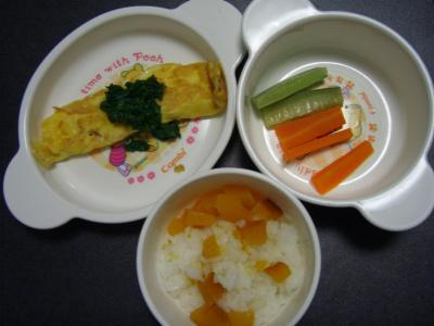 Pumpkin rice, vegetable sticks photograph of omelette, carrot and cucumber of salmon