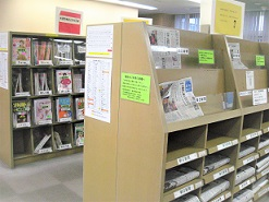 Photograph of corner of newspaper and magazine