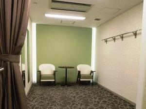 La fotografía del vestuario (espinazo del corredor fúnebre) para el hombre