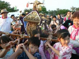 Children carrying a portable shrine