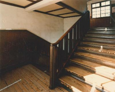 Photograph of wooden stairs of the branch school era