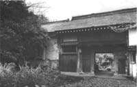 Image of 1975 gate of a tenement house style Park