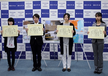 Image of four people that poster design was adopted